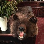 A stuffed bear greets you as in reception!