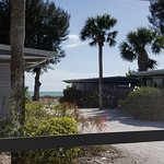 This is the view of the path and gulf from the screened porch on Sand Piper cottage