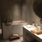 Double sink, heated floors, Japanese bath, and standing shower behind the wall.