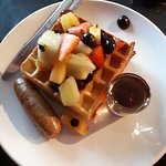 waffle with fruit and a sausage