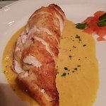 Chicken stuffed with banana in a very nice sauce.