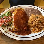 Beef enchiladas, beans, rice, guacamole salad