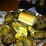 Here's what a dozen charbroiled oysters looks like. Absolutely delicious!