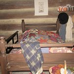 The bed inside the log cabin