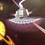 my favorite mural, a ufo with real fire alarm , and two painted fire alarms/thrusters on side.