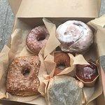 Doughnut Plant (cinn bun, creme brûlée, blackout, cinn sugar, peanut butter & jam, and vanilla b