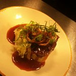 Beef cheeks served with fresh mash hispi cabbage crispy shallots and finished with an amazing re