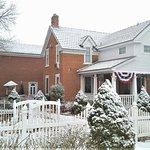 Front Of Heritage Inn after light snowfall