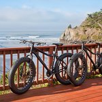 Guests can enjoy complimentary bike rental for beach cruising.