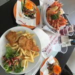 Bucket of Prawns and Barramundi & Chips with side salads.