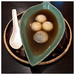 Black sesame dumplings in ginger syrup
