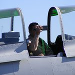 Military pilot taking pictures of all the visitors at the museum