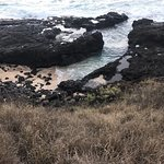 Small sea glass pretty cool black sand and the cemetery. Locals warn this is a place for murders