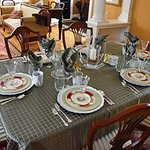 Dining table set with fine china and silver cutlery