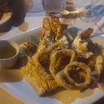 My meal-- Sea food; Grilled lobster tail, shrimp, fish, and fried calamari,