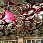 Ceiling in one of the dining rooms, hub caps