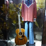 A guitar and outfit used by John Denver, in the Grammy Museum.