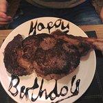 32oz Tomahawk Ribeye made extra special with Happy Birthday!