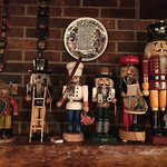A mantel lined with fancy nutcracker dolls