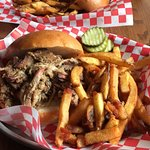 Two pulled pork sandwiches with fries