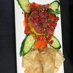 She Tuna Stack- Sashimi grade Ahi Tuna, Mango, and Avocado layered and topped with a sweet chili