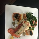 Seafood Combination- Lobster,  Prawns, Scallops,  and Clams with Lobster Sauce. Served with riso