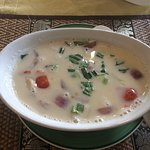 A very tasty but hot Tom khan Gai, coconut soup with mushrooms tomato and chicken