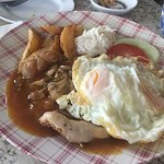 Grilled chicken chop with eggs and mushroom sauce