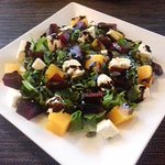 Beetroot & Pumpkin salad with Feta cheese Pumpkin seeds on a bed of rocket leaves & balsamic vin