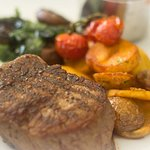 FILLET STEAK 8OZ  with sauté new potatoes, roasted cherry tomatoes, garlic mushrooms & spinach.