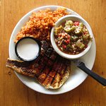 Grilled pork chop w/horseradish sauce, red rice & orca gumbo