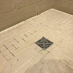 Tired grout in shower room