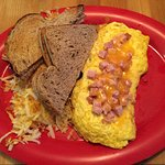 Ham and cheese omelet with hash browns and rye toast