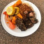 Jerk Chicken platter with rice and grilled vegetables