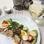 Tasty lunch, with tuna salad an a chardonnay.