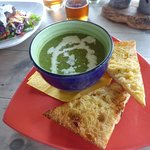 Small bowl of Pea and Mint Soup with bread
