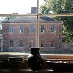 Seen through the windows of the kitchen is the Palace's carriage house.
