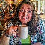 Coffee time at Crockets. My sweetheart enjoying her cup of coffee before a great breakfast.