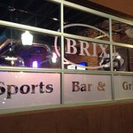 Sign for Sports Bar, Easy to find on Main St.