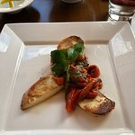 MOZZARELLA AFFUMICATA | Pan seared smoked mozzarella, roasted peppers, basil, extra virgin oil
