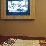 tv wall mounted with map on bed