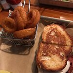 ham and cheese on grilled rye bread, onion rings