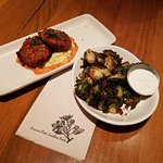 Happy Hour, fried green tomatoes with goat cheese grits with roasted pepper coullie, grilled bru