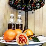 Complimentary water, oranges and turndown rose.