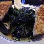 Steamed mussels in a garlic broth with side of thick toast for dipping