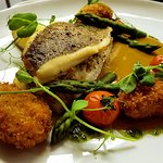 Lemon Sole stuffed with Fresh Crab Panko Crumbed Mussels, Asparagus and a Prawn Bisque.