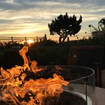 Sunset while sitting next to hotel fire pit