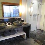 Bathroom sinks and walkin shower.