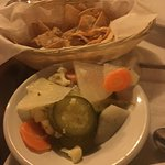 Complimentary chips and pickled vegetables