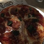 Sorry, we were in darker booth, and just snapped a quick photo of my Marathoner pizza. So good!